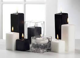 velas negras y blancas