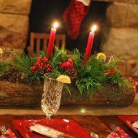 velas con tronco para decoración navideña