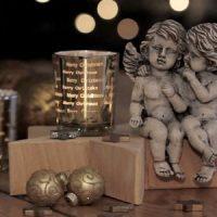 velas de navidad con estatua de angeles